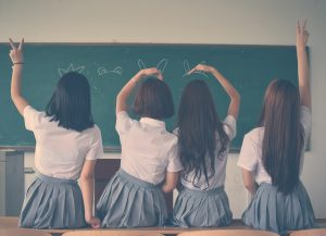 Image of girl children with smooth shiny hair in class room
