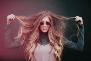 Image of a girl with long hair as if it needs a hair dryer to fix